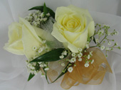 WHITE ROSE CORSAGE  in Ossining NY, Rubrums Florist Ltd.