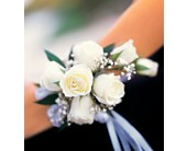 7 White Mini Roses Wristlet in Pasadena, Maryland, Maher's Florist