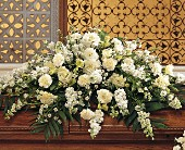 Pure White Casket Spray in Largo FL, Rose Garden Flowers & Gifts, Inc