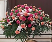 Delicate Pink Casket Spray in Largo FL, Rose Garden Flowers & Gifts, Inc