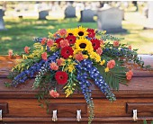 Vibrant Summer Casket Spray in St Augustine FL, Flower Works