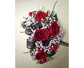 7 Red Mini Rose Corsage in Raleigh NC, Gingerbread House Florist - Raleigh NC