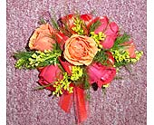 Red & Orange Mini Rose Corsage in Raleigh NC, Gingerbread House Florist - Raleigh NC