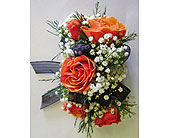 5 Orange Mini Rose Corsage in Raleigh NC, Gingerbread House Florist - Raleigh NC