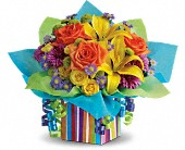 Teleflora's Rainbow Present in Aston PA, Wise Originals Florists & Gifts