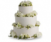 Freesia and Ranunculus Cake Decoration in Indio, California, Aladdin's Florist & Wedding Chapel