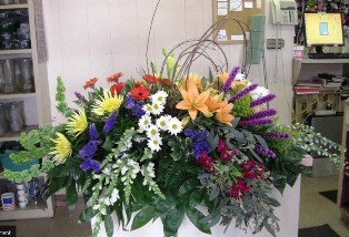 Radiant Medley Casket Spray in Pell City AL, Pell City Flower & Gift Shop