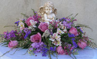 ON ANGELS WINGS SYMPATHY ARRANGEMENT by Rubrums in Ossining NY, Rubrums Florist Ltd.