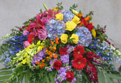 COLORFUL MEMORIES CASKET SPRAY by Rubrums in Ossining NY, Rubrums Florist Ltd.