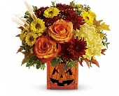 Teleflora's Halloween Glow in Redwood City CA, A Bed of Flowers