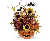 Teleflora's Trick & Treat Bouquet in Charleston WV, Food Among The Flowers