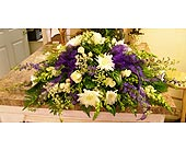 Purple and yellow casket spray in Melbourne FL, Paradise Beach Florist & Gifts
