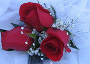 3 RED ROSE W/ R. STONES CORSAGE in Ossining NY, Rubrums Florist Ltd.