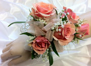 PEACH SPRAY ROSE WRIST W/ PEARLS in Ossining NY, Rubrums Florist Ltd.