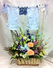 BABY BOY CLOTHESLINE by Rubrums in Ossining NY, Rubrums Florist Ltd.