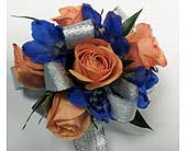 Orange Mini Rose & Blue Delphinium Corsage in Raleigh NC, Gingerbread House Florist - Raleigh NC