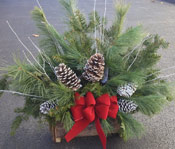 LARGE WINTER GREENS LOG by Rubrums in Ossining NY, Rubrums Florist Ltd.