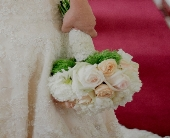 Bride bouquet with lace wrap in Midwest City, Oklahoma, Penny and Irene's Flowers & Gifts