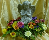 Small Angel Statue With Wreath in Frankfort, Illinois, The Flower Cottage
