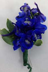 BLUE DELPHINIUM BOUTONIEERE in Ossining NY, Rubrums Florist Ltd.