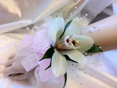 WHITE CYMBIDIUM CORSAGE WITH PEARLS in Ossining NY, Rubrums Florist Ltd.