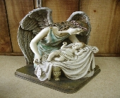 Angel and Child Figurine in Ionia MI, Sid's Flower Shop
