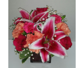 Lilies and Roses in Raleigh NC, Gingerbread House Florist - Raleigh NC