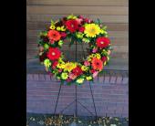 Vibrant Sympathy Wreath in Longmont, Colorado, Longmont Florist, Inc.