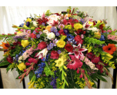 SPRING MEADOW CASKET SPRAY in Lake Charles LA, A Daisy A Day Flowers & Gifts, Inc.