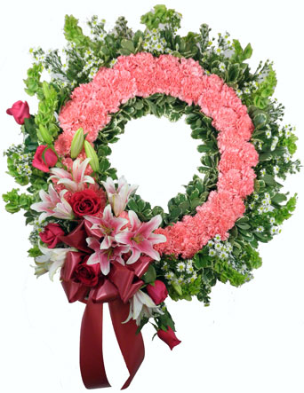 Pink Wreath with Roses and Lilies in Omaha NE, Piccolo's Florist