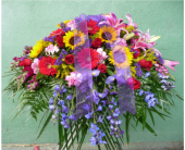 Casket Spray- Pink, Red, Yellow, and Purple in Islip NY, Flowers by Chazz