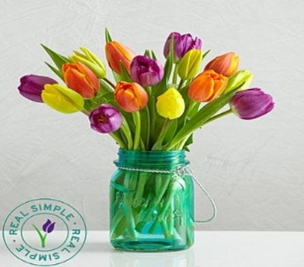 Assorited mixed tulips in a Mason jar in Largo FL, Rose Garden Flowers & Gifts, Inc