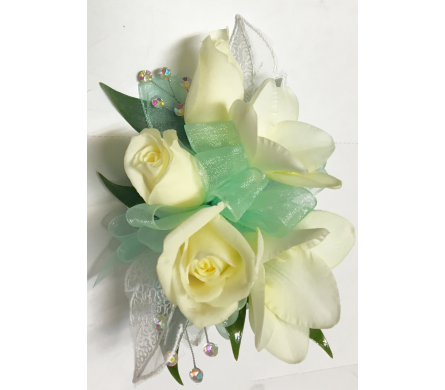 White Flowers With Aqua Green Wrist Corsage in Wyoming MI, Wyoming Stuyvesant Floral